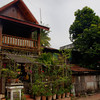 "<a href=""http://nomadicsamuel.com"">http://nomadicsamuel.com</a> : Luang Prabang is one of my favourite cities in all of Asia. It's a quiet retreat from nearby hectic metropolises. This 30 part slideshow series showcases Luang Prabang, Laos: monks, temples, hills, scenery, people, markets  Colour is the first of Luang Prabang's virtues to greet travellers. Pearly frangipanis with their heady perfume, banks of overgrown trees peppered with scarlet flowers, the burnt sienna robes of hundreds of monks and their novices, and resplendent gold and claret wats. The scent of fresh coffee, river activity, produce markets and spicy food soon follows. And then the broader aesthetics begin to unfold. Encircled by mountains, and set 700m above sea level at the confluence of the Nam Khan (Khan River) and the Mekong River, Luang Prabang is now Laos' foremost tourist showpiece. The brew of gleaming temple roofs, crumbling French provincial architecture and multiethnic inhabitants captivates even the most jaded travellers, and the quiet benevolence of the city's residents lulls them into a somnambulant bliss.  Sealed highways linking Luang Prabang with Thailand and China have turned the city into an important relay point for commerce between the three countries. City governors have wisely provided a road bypass system that gives the city centre a wide berth. Thus the sense of calm antiquity that first brought visitors to the city when Laos opened to tourism in 1989 has been well preserved. More­over, the city is Unesco Heritage listed, which means a blessed ban on buses and trucks. Most road activity consists of bicycles or motorcycles, but an even score simply go by foot. Although the city teems with travellers, it is not a party destination, and the 11.30pm curfew silences the city by midnight and maintains its traditional disposition: <a href=""http://www.lonelyplanet.com/laos/northern-laos/luang-prabang"">http://www.lonelyplanet.com/laos/northern-laos/luang-prabang</a>  Proudly presented by <a href=""http://teach-english-travel-overseas.com"">http://teach-english-travel-overseas.com</a> , <a href=""http://travel-photography-tips.com"">http://travel-photography-tips.com</a> , <a href=""http://smilingfacestravelphotos.com"">http://smilingfacestravelphotos.com</a> , <a href=""http://nomadicsamuel.com/top100travelblogs"">http://nomadicsamuel.com/top100travelblogs</a> <a href=""http://howtomakemoneytravelblogging.com"">http://howtomakemoneytravelblogging.com</a>"
