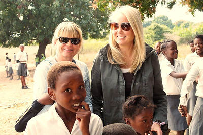 Lyn Pedersen and Sacha Mock with students at Nkomo Primary School