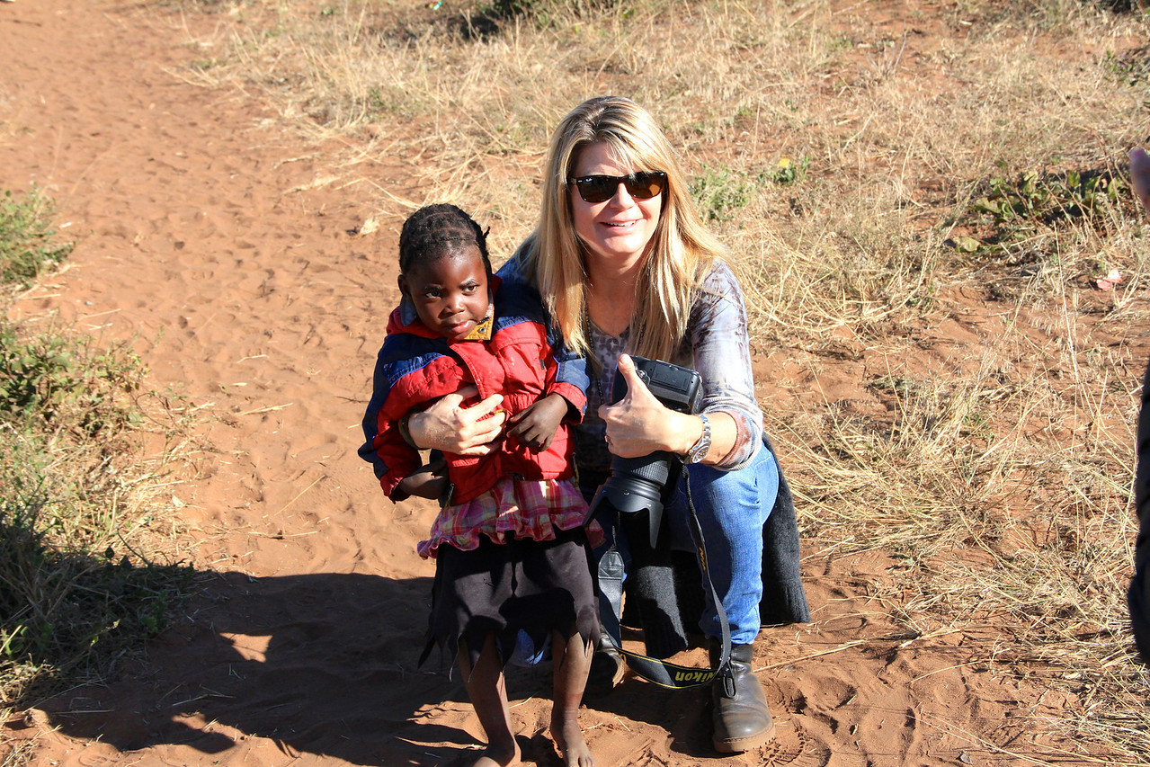 Empowers Africa Trustee with a young learner in Zambia