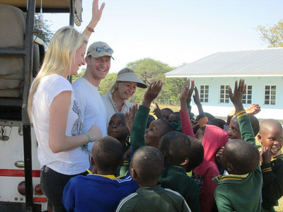 Gabriella, RIchard, & Lisa share a delightful moment with the students at Ziga primary school.
