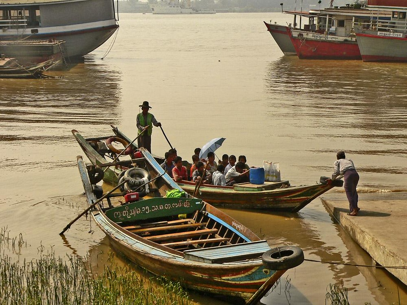 Yangon River Landing - Yangon is surrounded on three sides by water --its busy port is on the Yangon River. Aged boats of all kinds jam the harbor. This scene could have just as easily been photographed in 1905 as in 2005.