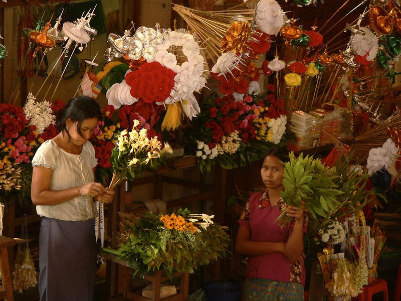 Flower shop, Shwedagon - The floral offerings overwhelm the women who sell them at Schwedagon Pagoda.