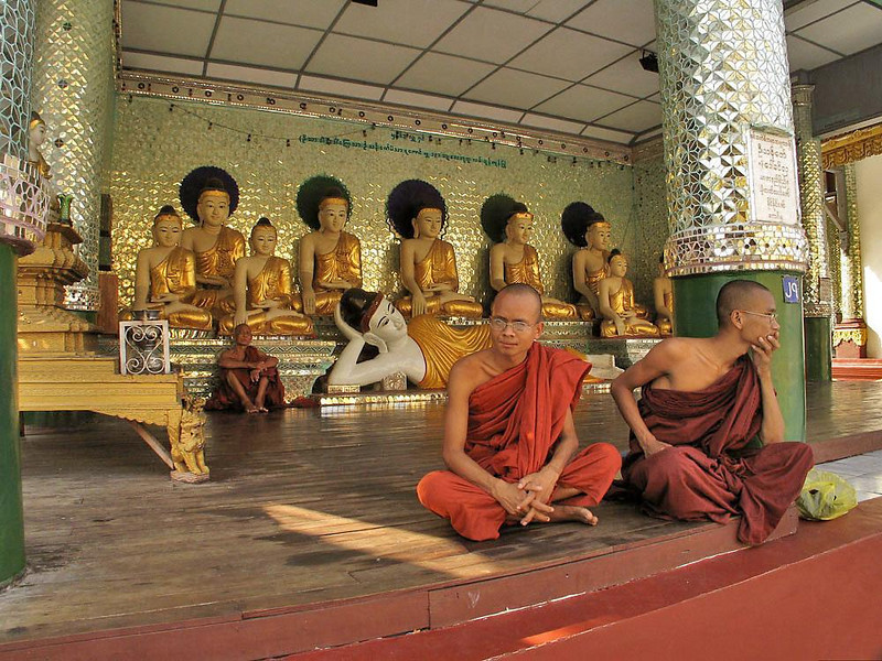 Monks at Shwedagon - Monks must renounce all possessions except for three robes, a razor, a sewing needle, a strainer, a belt, and an alms bowl. They must also vow to injure or offend no one, and remain celibate.