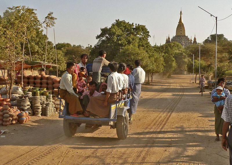 Local Bus to the Ananda Temple, Bagan - Bagan, 15 square miles of plains holding the most beautiful ruins in Burma, is all that remains of the once mighty capital of the first Bamar Kingdom (11th to 14th centuries AD). The most impressive of its ruins is the Ananda Temple, completed in 1091.
