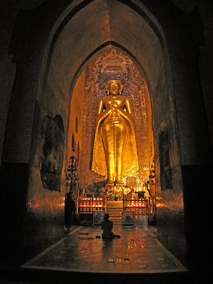 A Bagan Gem: Buddha of the Ananda - One of the most spectacular sights of Bagan are the four 31 foot tall teak Buddha images that still stand within the ruins of the Ananda Temple. This is one of two originals, each of them nearly a thousand years old.