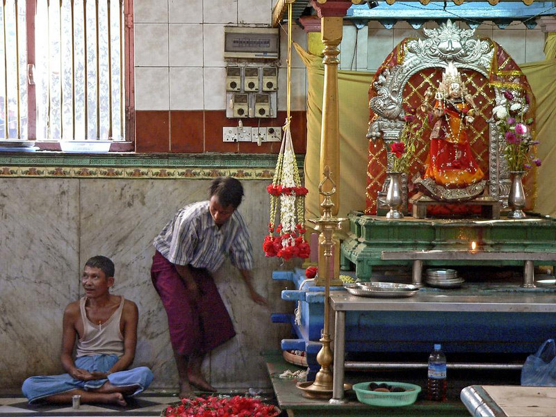 Offering, Hindu temple, Yangon - A man rises from prayer following his offering to a Hindu god.