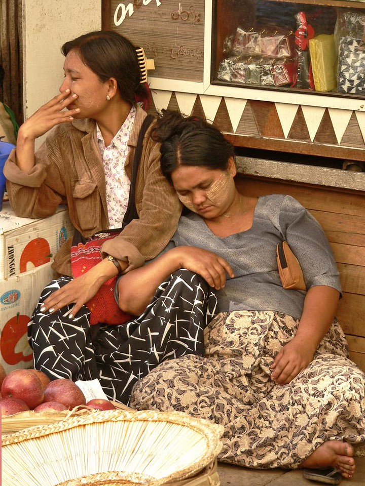 Nodding off, Chinatown, Yangon - Customers were few at this vendor's stall in Yangon's Chinatown. There was enough time for these women to get some obviously needed rest.