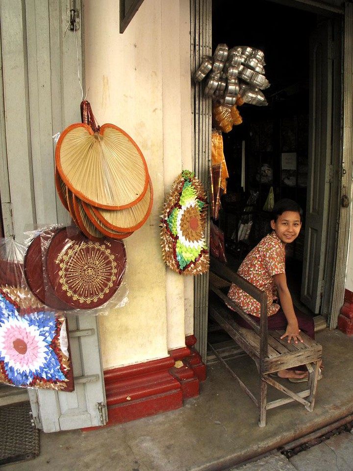 Religious Goods shop, Chinatown, Yangon - This young woman sells all kinds of religious paraphernalia -- including fans and cushions used by monks.