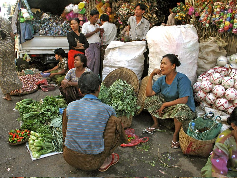 Chinatown produce market, Yangon - It's a family business -- and toys apparently help move the veggies.