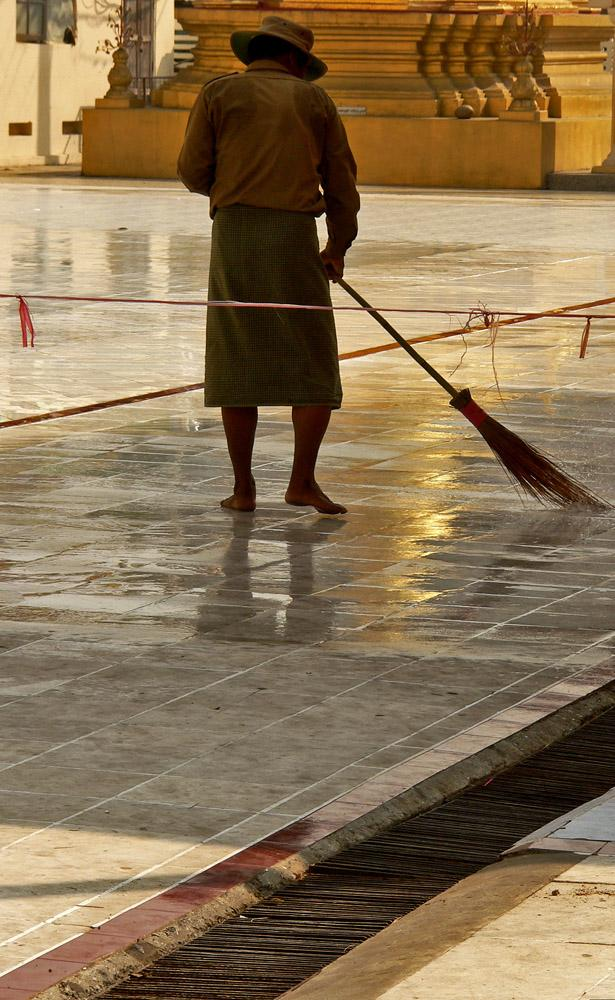 Sweeper, Botataung Pagoda, Yangon - As it has for centuries, Yangon cleans its streets and temples by hand. Here, Botataung Temple undergoes a morning scrubdown.