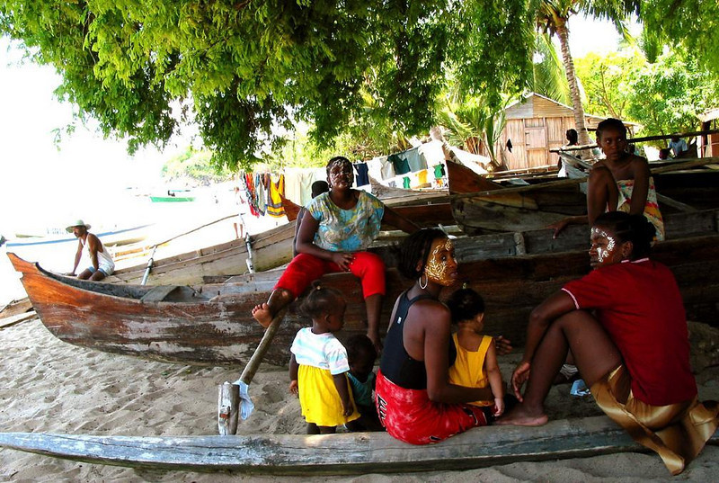 Waterfront, Ampangoriana Village - I found this family group enjoying the shade on Ampangoriana's waterfront. They sit among the fleet of canoes that provide local transportation.