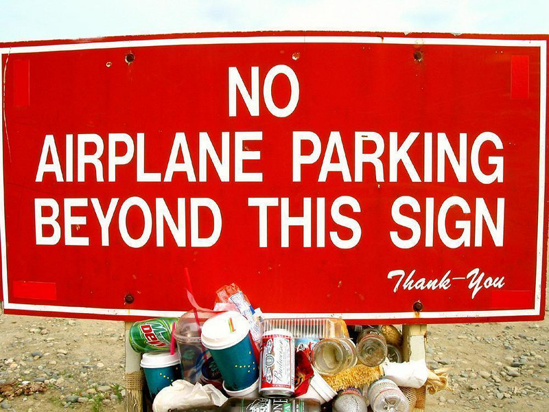 Only in Alaska - Small planes are so plentiful in Alaska that we saw them parked everywhere. In Talkeetna, this sign had to be displayed to keep them from taking up parking space needed for cars. To save even more space, the sign was posted on a trash bin. And all of this in a state that has more space than any other.