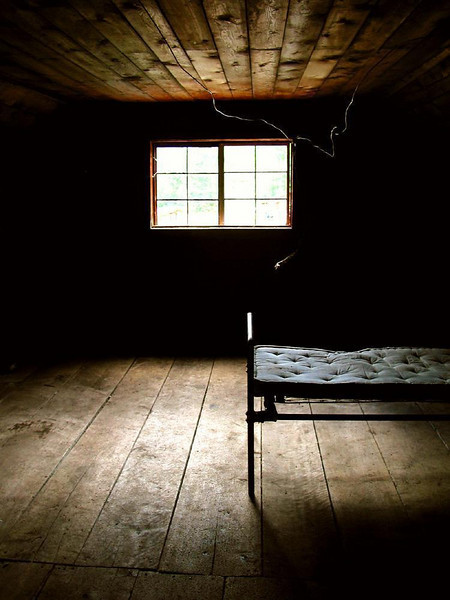 No-frills room in Alaska - For many who live in Alaska's remote communities, life is often honed down to the essentials. This room, preserved as part of Hope's museum, offered warmth, a bed, and a wire for a light.