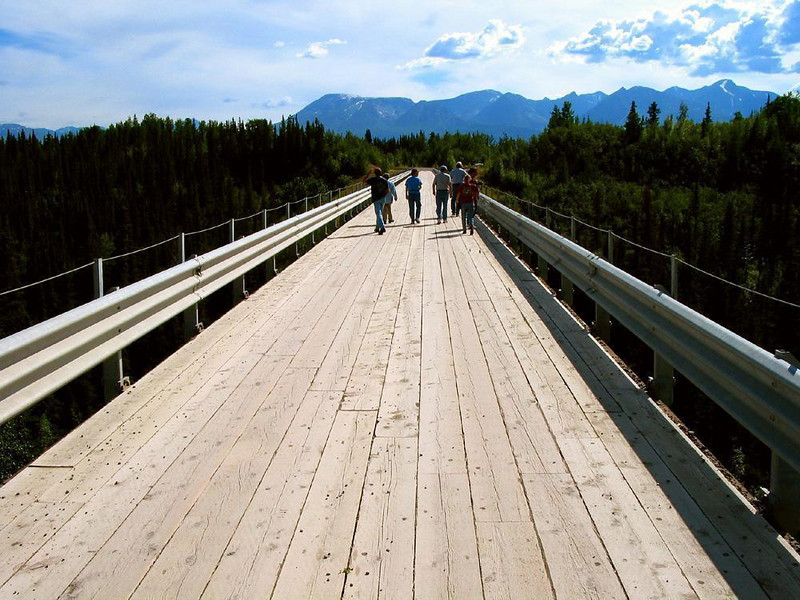 On the Bridge over the Kulskana River - We were offered a brief respite from the brutalities of the gravel road between Chitina and McCarthy by taking a stroll on the flat, firm boards of this bridge over the Kulskana River.