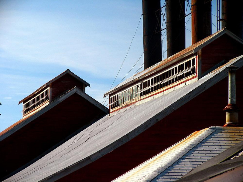 Kennecott's silent power plant - The geometric patterns created by sunlight striking the rooftops of Kennecott's vast but empty power plant recall the glory days of early 20th Century heavy industry.