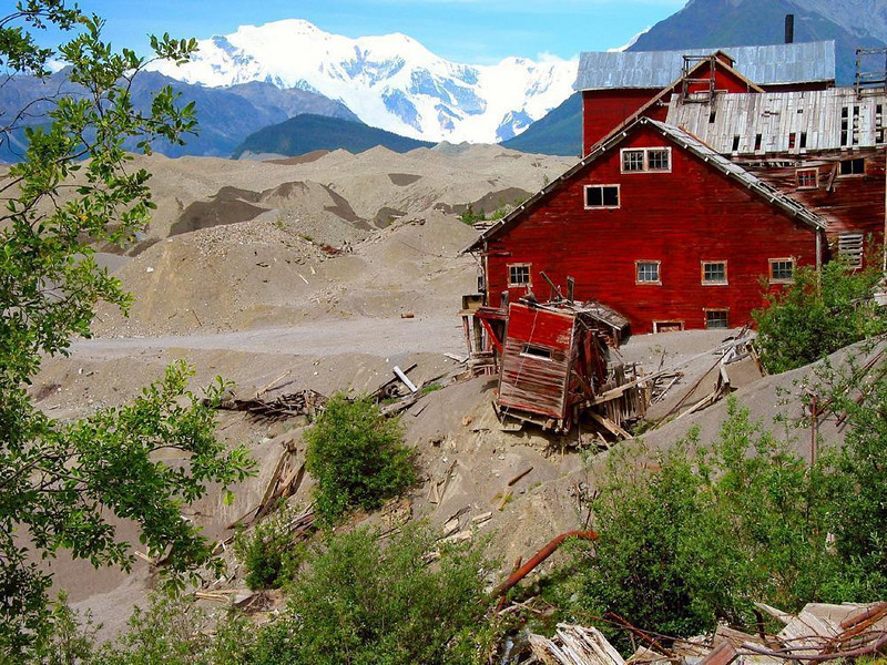 A Kennecott building crumbles - Exploring the ghost town of Kennecott can be hazardous. Many of the buildings are unsafe -- in this photograph we see one of them literally falling apart before our eyes.