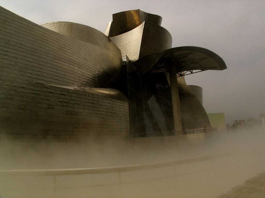 Guggenheim afloat, Bilbao - The Guggenheim Museum, designed by Frank Gehry, became the symbol of Bilbao as soon as it opened in 1997. The huge structure, covered in titanium sheets, seems to be afloat on a sea of mist, which billows around the museum on the hour.