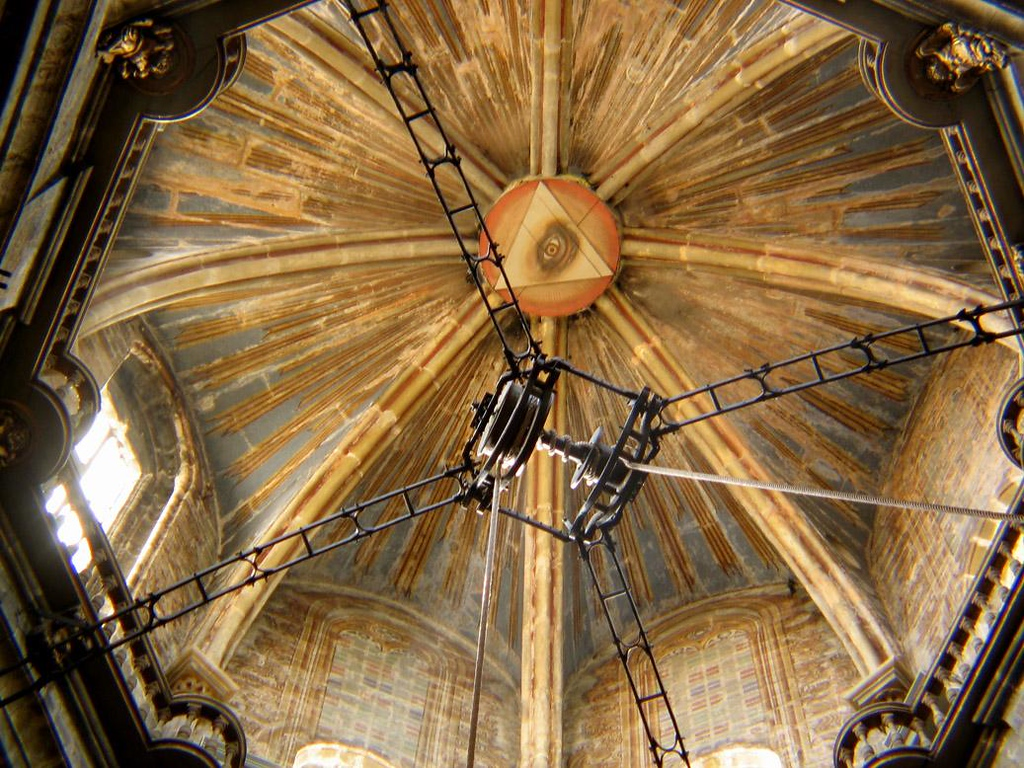 Censor Pulleys, Santiago Cathedral - Under the ceiling of the church's massive dome, featuring an omnipresent eye, is a unique pulley system, designed in the 16th century for the support and movement of the botafumeiro, the largest censor in the world. It is used to perfume the air, which for centuries has reeked with the sweat of exhausted pilgrims. The huge censor swings from these pulleys from one side of the cathedral to the other, hurled and guided by a group of eight men known as tiraboleiros. This ceremony, performed once a day, draws thousands to the church.