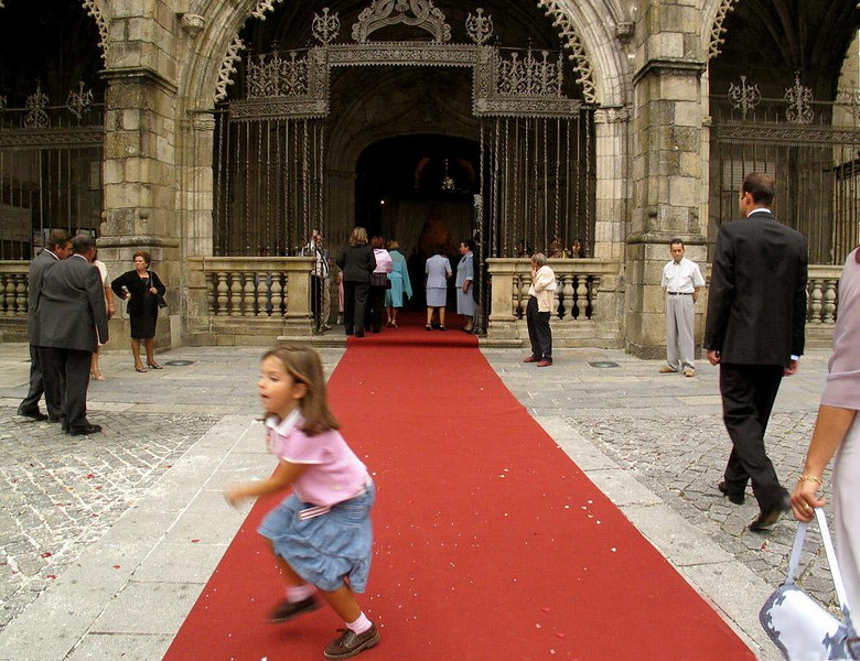 Another wedding in Braga, Portugal - There was a series of weddings at Braga's Cathedral while we were visiting the town. Later that day, I caught this young girl doing her own wedding dance while guests enter along the red carpet that extended several blocks from the Cathedral.