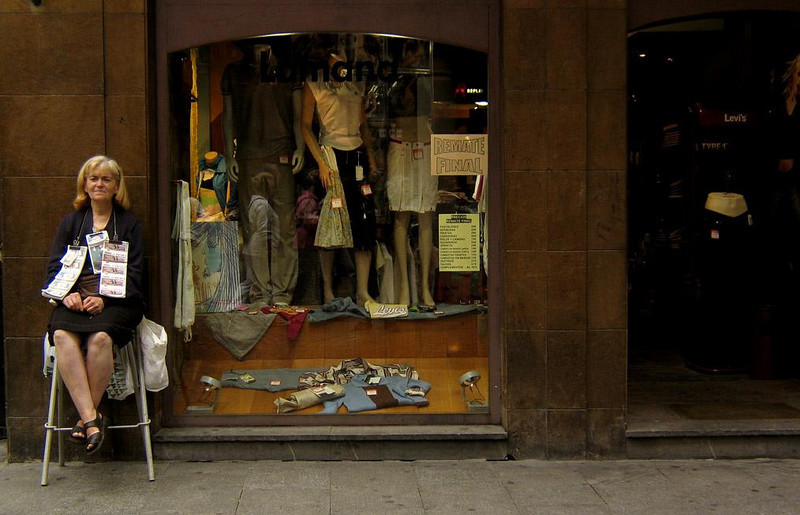 Lottery ticket seller, Bilbao - Economics 101 in Bilbao. Either buy a lottery ticket from her and hope for the best, or catch a good deal on clothing while you can.