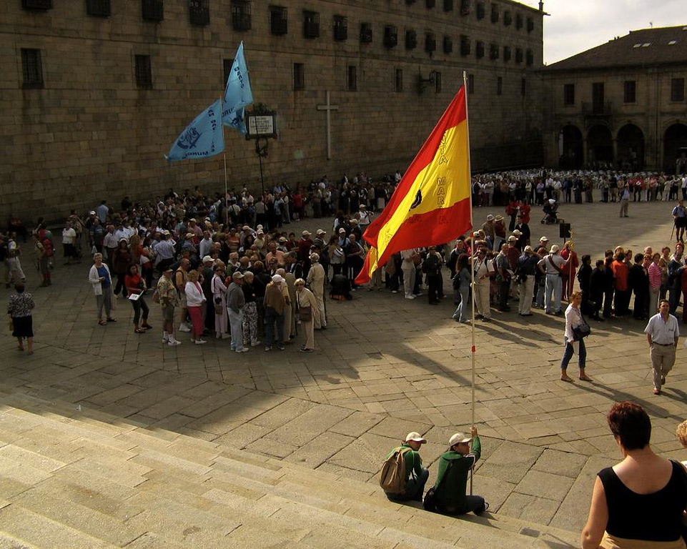 Pilgrimage, Santiago de Compostela - A festival honors St. James every July 25th. If that day falls on a Sunday, that whole year is declared holy and celebrations abound. 2004 was one of those years, and during our visit in September, the streets of Santaigo were jammed with thousands of singing pilgrims bearing flags of their own churches and waiting patiently for hours to visit the tomb of their saint. More than seven million people visit Santiago in a holy year, and it seemed to me that all of them were there with us.