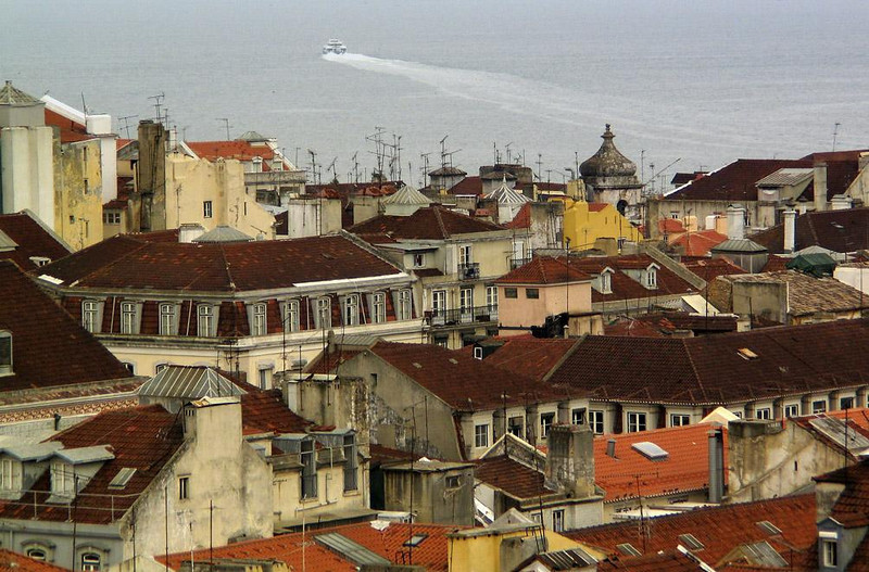 Rooftops of Lisbon, Portugal - Our 2004 summer cruise ends in Lisbon, capital city of Portugal, one of the oldest cities in Europe. Dating back to Phoenician and Roman times, the city was occupied by the Moors for 450 years, and later became the home base of mariners who opened up new sea routes around the world. In 1755 an earthquake destroyed Lisbon and killed 15,000 its residents but the city came back in glorious style. I have tried to capture some of those glories in the photographs that follow.