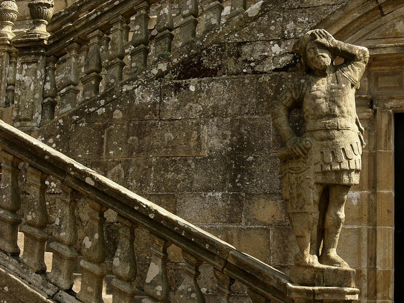 Crypt Guard, Cathedral of Santiago - The front entrance of Santiago's great Cathedral, known as El Obradoiro, was built in the mid 1700s. At the foot of the staircase leading up to the entrance is a door to the Crypt of St. James. This figure has guarded that door for over 250 years.
