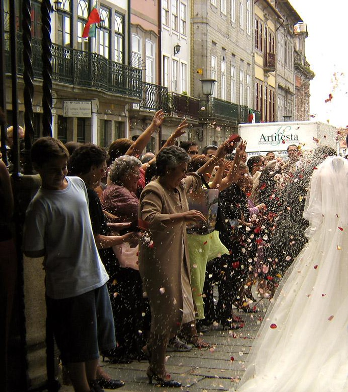 Storm of flowers, Braga, Portugal - Friends and family of Braga's newlyweds greet them with hail of flower petals and rice.