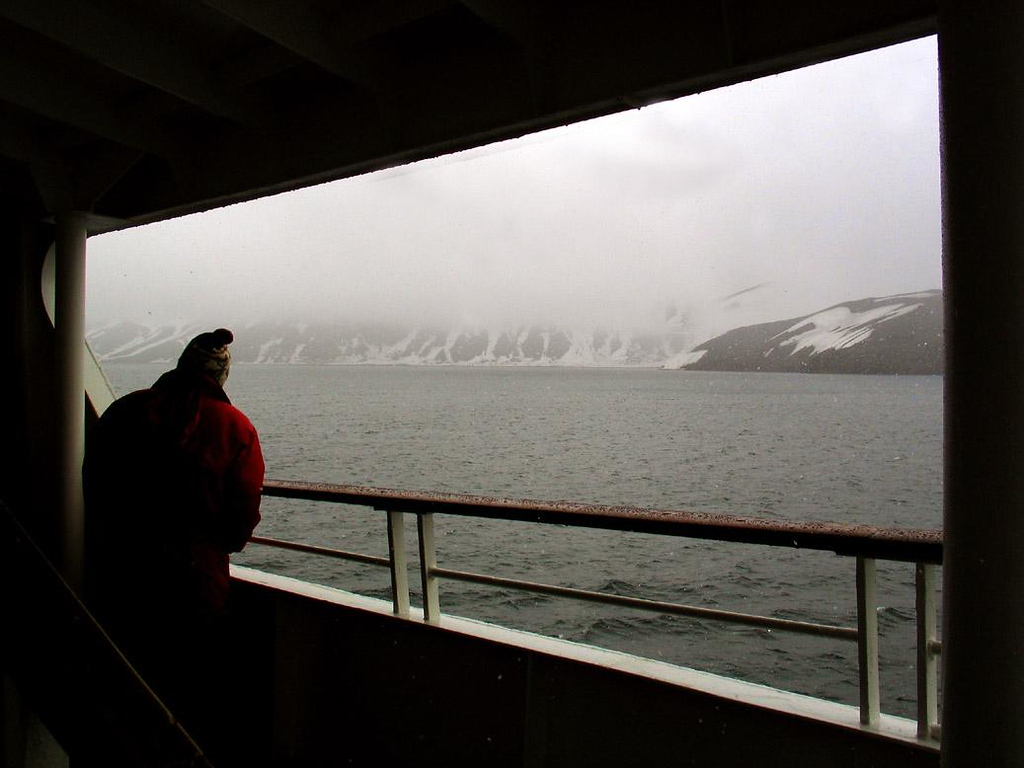 Snow in the Caldera, Deception Island - As we reached the midst of the steaming caldera in the middle of Deception Island, the falling Antarctic snow intensified, and the volcanic rock slopes of the crater could barely be seen.