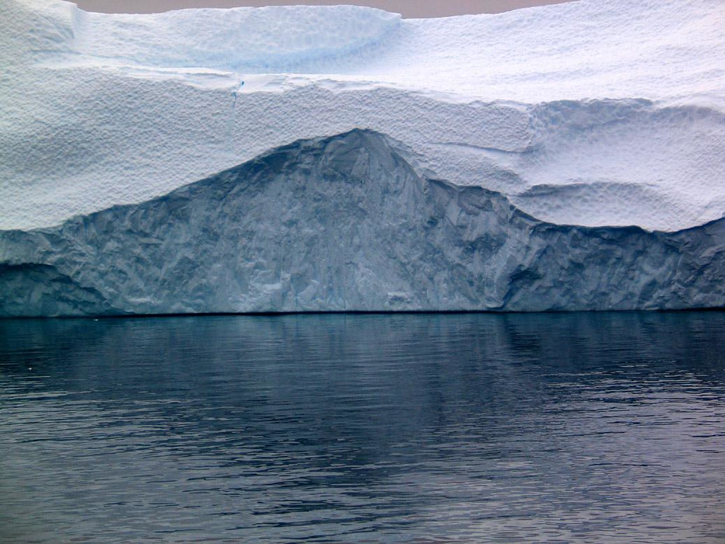 Tabular Iceberg - Tabular icebergs are chunks of Antarctica's permanent ice shelf that have broken off and floated away. This one is enormous, a study in icy textures.