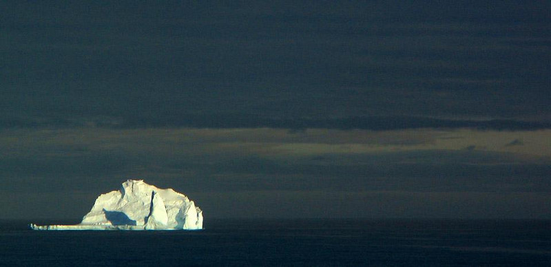 The Ice Castle - Somewhere off the South Shetland Islands, we saw this huge iceberg, as large as a small mountain, afloat in the distance. It seemed like a giant ice palace, surrounded by towers and turrets.