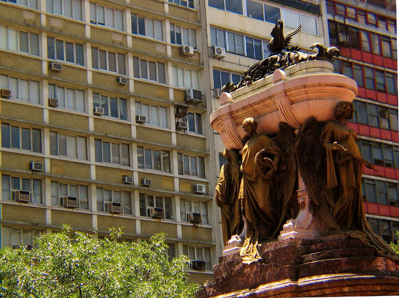 Belgrano's Tomb, Buenos Aires - The ornate marble sarcophagus of General Manuel Belgrano, a heroic figure in Latin America's revolution, stands opposite the apartment buildings of contemporary Buenos Aires. It is ironic that Belgrano, who died impovershed in 1820, is currently portrayed on Argentine currency.