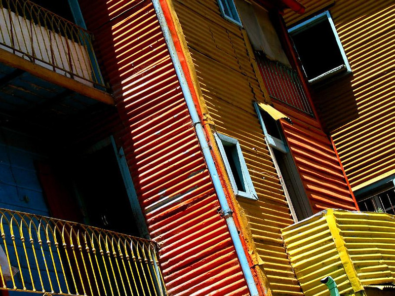 Pattern and Color, La Boca, Buenos Aires - La Boca is famous for the vivid colors of its buildings. Unlike my rainy visit to this Buenos Aires neighborhood a year earlier, the sun was out for me this time, and the angle of light made the corrugated metal siding of these buildings standout in bold relief. This blend of striking primary colors and powerful patterns create a memorable impression, unique to La Boca.