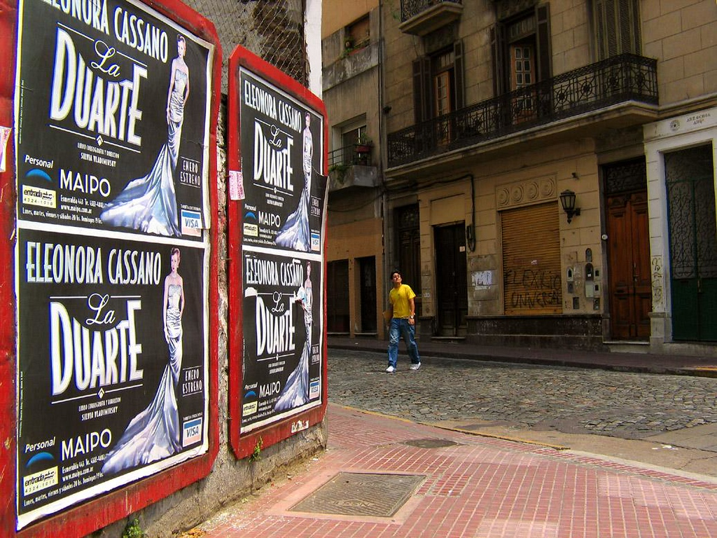 San Telmo Corner, Buenos Aires - The posters are advertising a play about Eva Duarte Peron, whose controversial life and political career still divides public opinion in Argentina. I contrasted this promotional overkill to the disinterested body language of the fellow wandering across this deserted San Telmo corner.