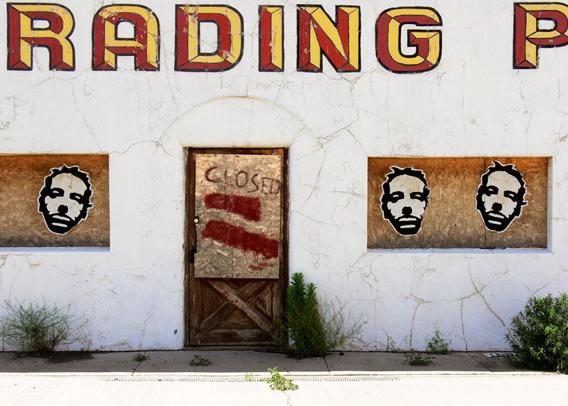 Twin Arrows Trading Post - Twin Arrows was probably a post World War II development. A classic complex of truck-stop, trading post, gas station, and cafe, it has closed down and is withering in the Arizona desert sun. Today its trading post is sheathed in graffiti covered plywood.
