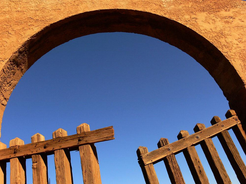 The open gate, La Posada, Winslow - Architect Mary Colter's vision -- never completed --included acres of public gardens surrounding the hotel. Work is now underway to make them a reality. Meanwhile, this ancient gate leads from La Posada's undeveloped gardens to the outside world.