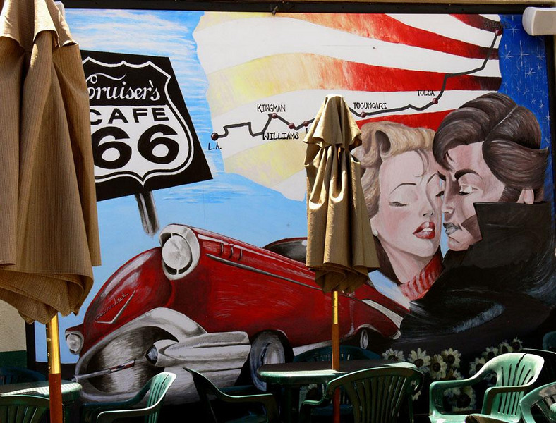Cruisers Cafe, Williams, Arizona - In 1984, Williams, Arizona, became the last town to be bypassed by the Interstate highway system. Cruisers Cafe sits alongside of what once was Route 66. It is now Williams' Main Street. The huge mural pays homage to the legendary automobiles that once made the long run from Chicago to LA -- and passed right through the heart of Williams.