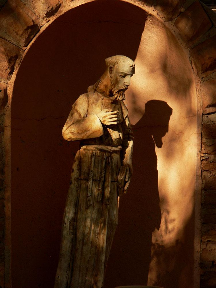 Glowing saint, La Posada, Winslow - I found this saintly sculpture set within a niche in La Posada's garden wall. The early morning sun illuminates it exactly as architect Mary Colter planned.