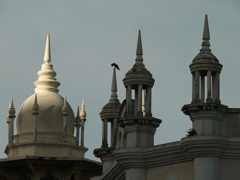 Crow-eye view, Kuala Lumpur, Malaysia - The Moorish spires of KL's historic railroad station serve as lookouts for some of the city's resident crows.