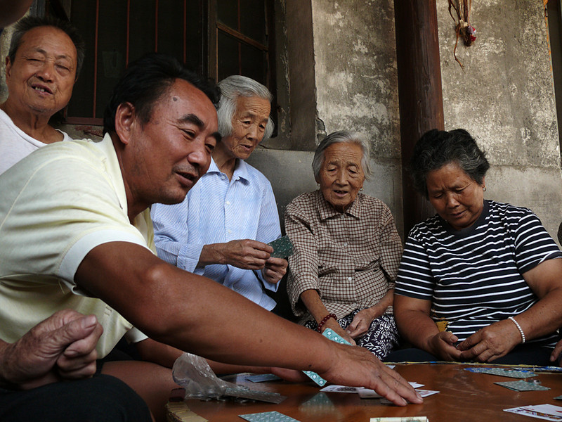 Card game, Feng Jing, China - Feng Jing is an ancient Chinese city about an hours drive from Shanghai. Playing cards in the village square is a community event. Who is winning here?