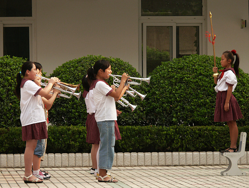 School flag raising, Nanjing, China - The drum major leads the school band in a rousing rendition of patriotic music as the national flag is hoisted behind her.
