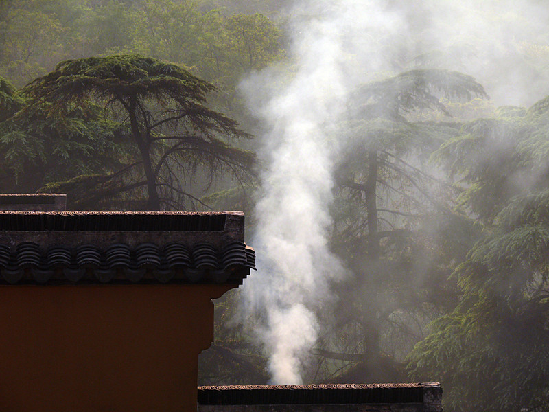Chimney, Ji Ming Temple, Nanjing, China - The long column of smoke, spreading out into the surrounding forest, brings a timeless, spiritual mood to the grounds of this ancient temple.