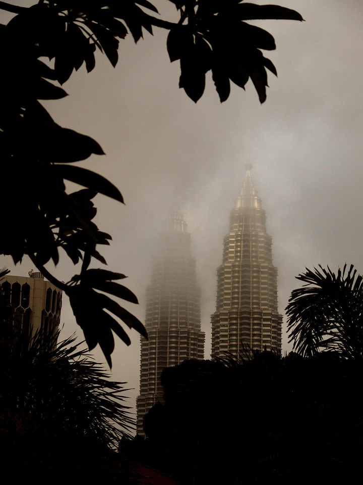 Petronas Towers, Kuala Lumpur, Malaysia - These were the world's tallest towers from 1998 to 2004, and remain the highest twin structures on earth. I found them most impressive in the rain and fog.