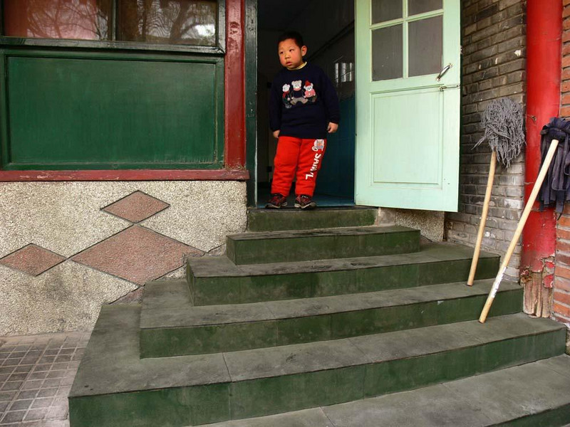 Hutong primary school, old Beijing - This child attends school in one of Beijing's old Hutongs -- a labyrinth of alleyways lined with four sided courtyard homes.