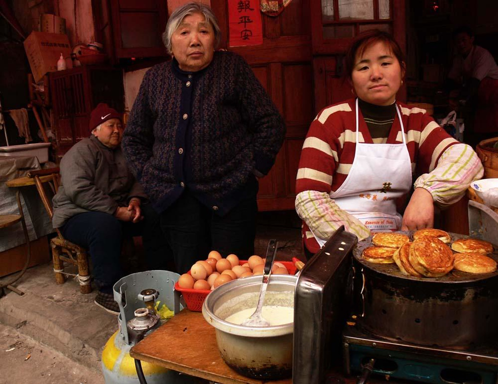 Street food in Old Shanghai - The Old City of Shanghai is lined with small stalls and shops. Some, like this one, sell quick snacks to passersby.