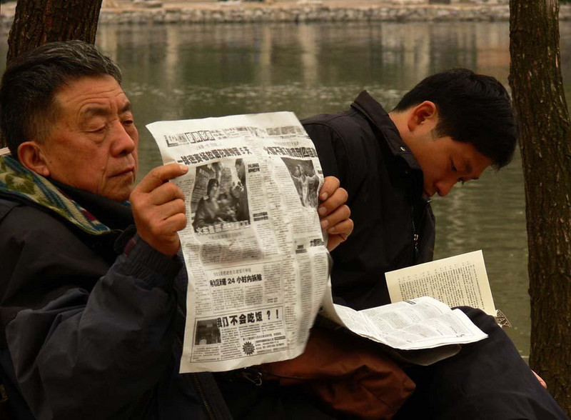 Readers in Shanghai's Luxun Park - Bundled against the morning chill, these Shanghai residents prefer to do their reading outdoors.