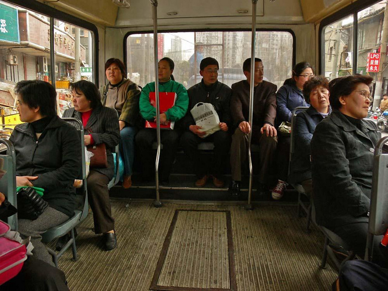 Shanghai commuters - With nearly 13 million residents, Shanghai is the tenth largest metropolitan area on earth. It offers its commuters a vast mass transportation system, including crowded buses such as this one.