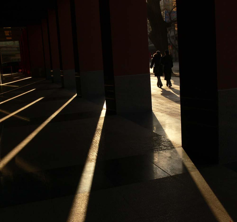 Rays of dawn in Beijing - The early morning sun creates the pattern of dawn on a Beijing street.