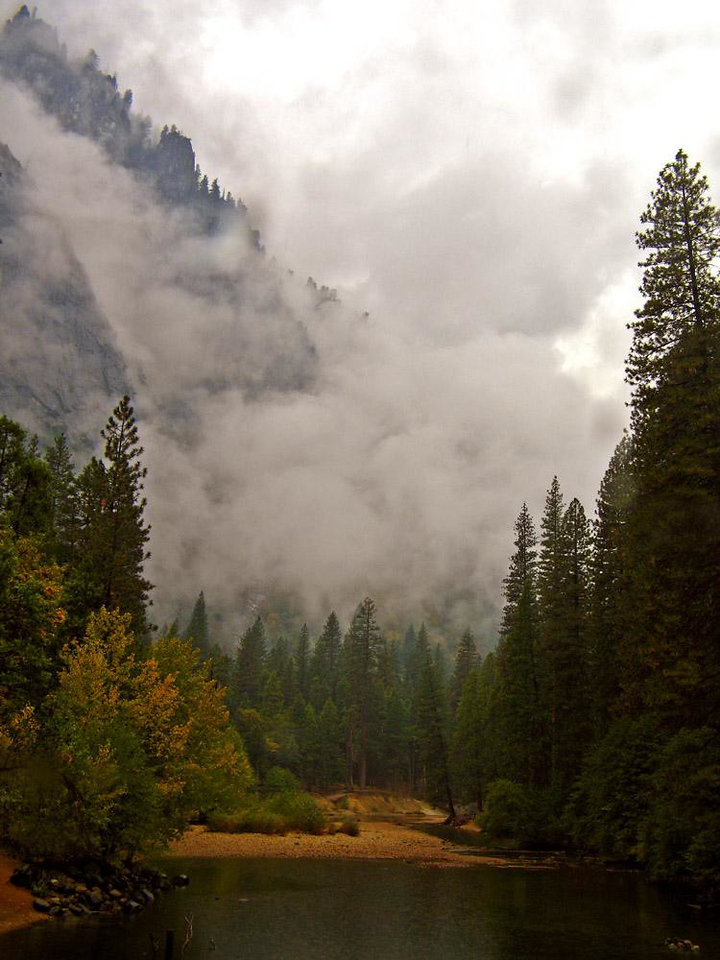 Storm over Yosemite at Stoneman Bridge - Sun is wonderful, but rain soaked Yosemite can be just as stirring. These sodden clouds were drenching this photographer, but I couldn't stop admiring their impressive advance on the towering cliffs that flank the Merced River.