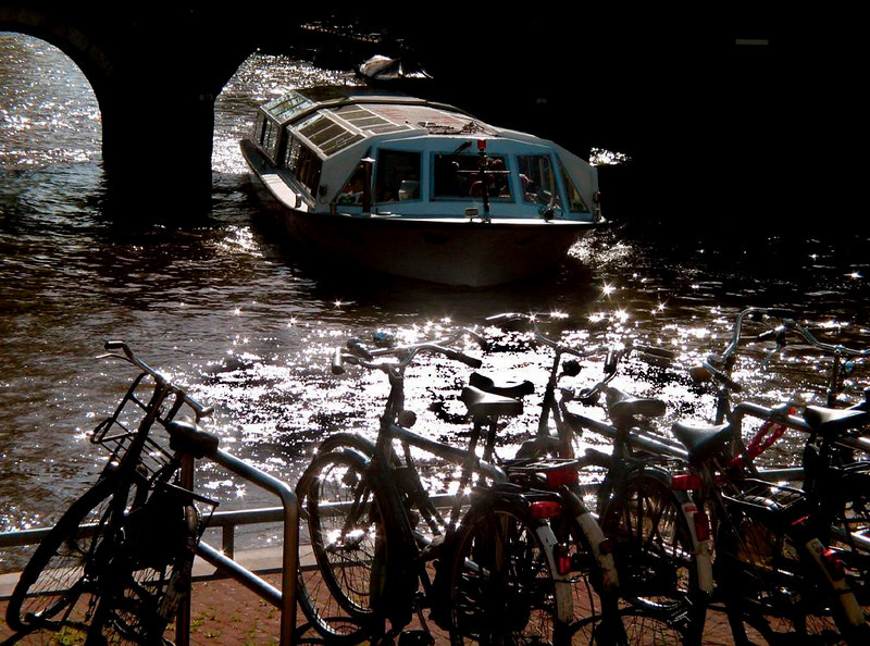 Getting around Amsterdam - Amsterdam moves by boat, bike, tram, and foot. There is very little room to park.